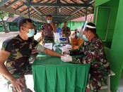 Anggota Kodim 0708 Purworejo, saat menjalani vaksinasi, Kamis (04/03/2021) - foto: Sujono/Koranjuri.com