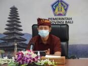 Kepala Biro Organisasi Setda Provinsi Bali I Wayan Serinah mengikuti kegiatan SAKIP Award 2020 secara online dari Ruang Press Room Kantor Gubernur Bali, Kamis, 22 April 2021 - foto: Istimewa
