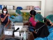 Vaksinasi untuk pelaku perjalanan di Wantilan DPRD Bali, Minggu, 4 Juli 2021 - foto: Koranjuri.com