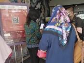 Mall di Bali menerapkan persyaratan wajib dengan mengunduh aplikasi PeduliLindungi ketika masuk dan keluar pusat perbelanjaan - foto: Koranjuri.com