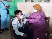 Vaksinasi di SMPN 15 Purworejo, Senin (13/09/2021) - foto: Sujono/Koranjuri.com