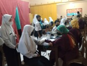 Vaksinasi di SMPN 4 Purworejo, Selasa (14/09/2021) - foto: Sujono/Koranjuri.com