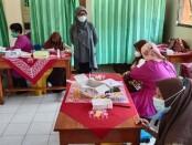 Pelaksanaan vaksinasi di SMPN 34 Purworejo, Sabtu (18/09/2021) - foto: Sujono/Koranjuri.com